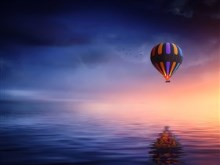 Hot Air Balloon over Calm Sea